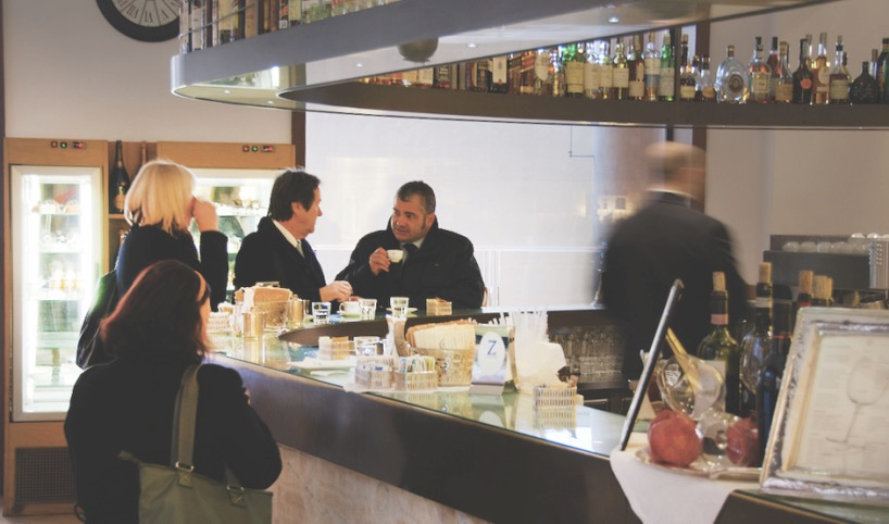 Picture of Italian bar and people drinking espresso while standing