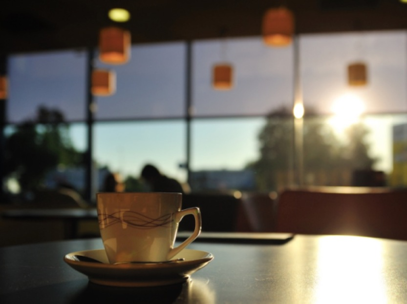 picture of a coffee cup on a table at a coffee shop