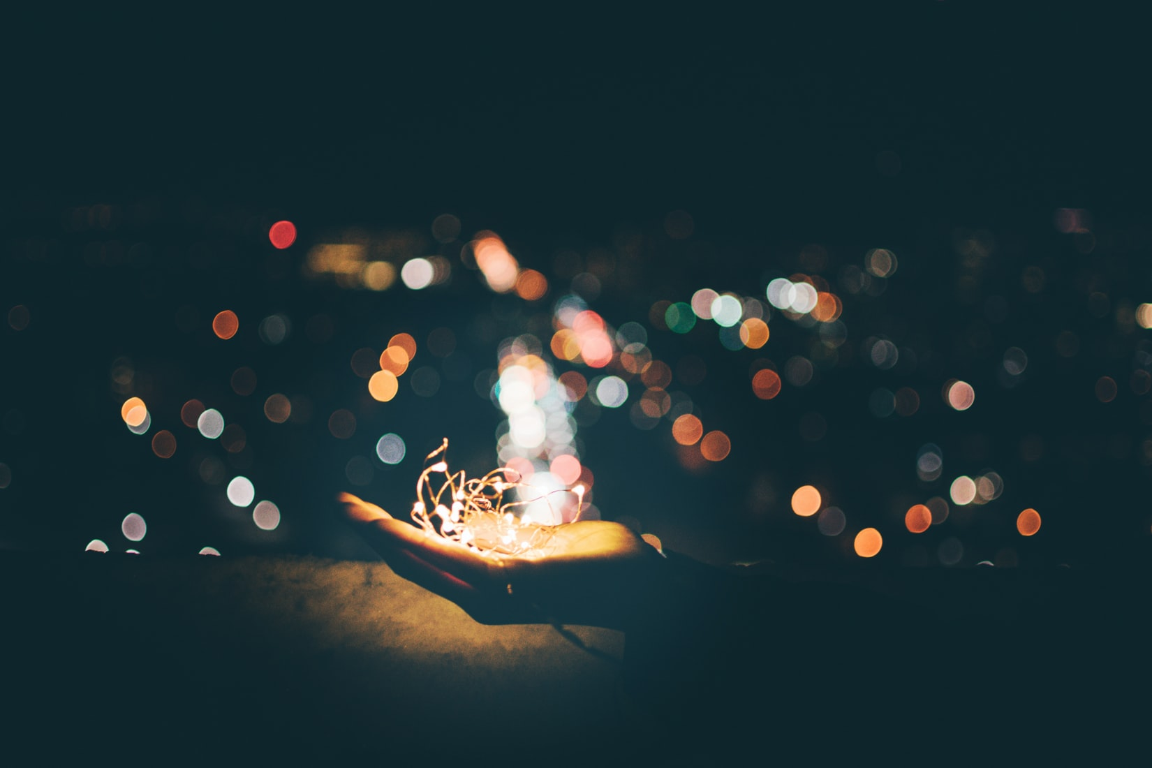 photo of a hand holding out lights