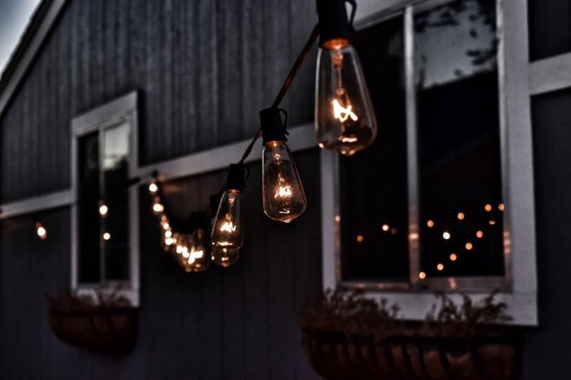 photo of a house with edison bulb string lights